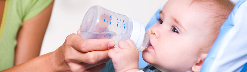 Baby Drinking Rainwater from Bottle